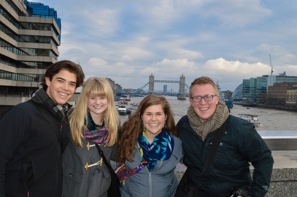 Sam Panzer, Allison Schmidt, Karen Holt, and Taylor Wasvick on London Bridge with Tower Bridge visible in the background.