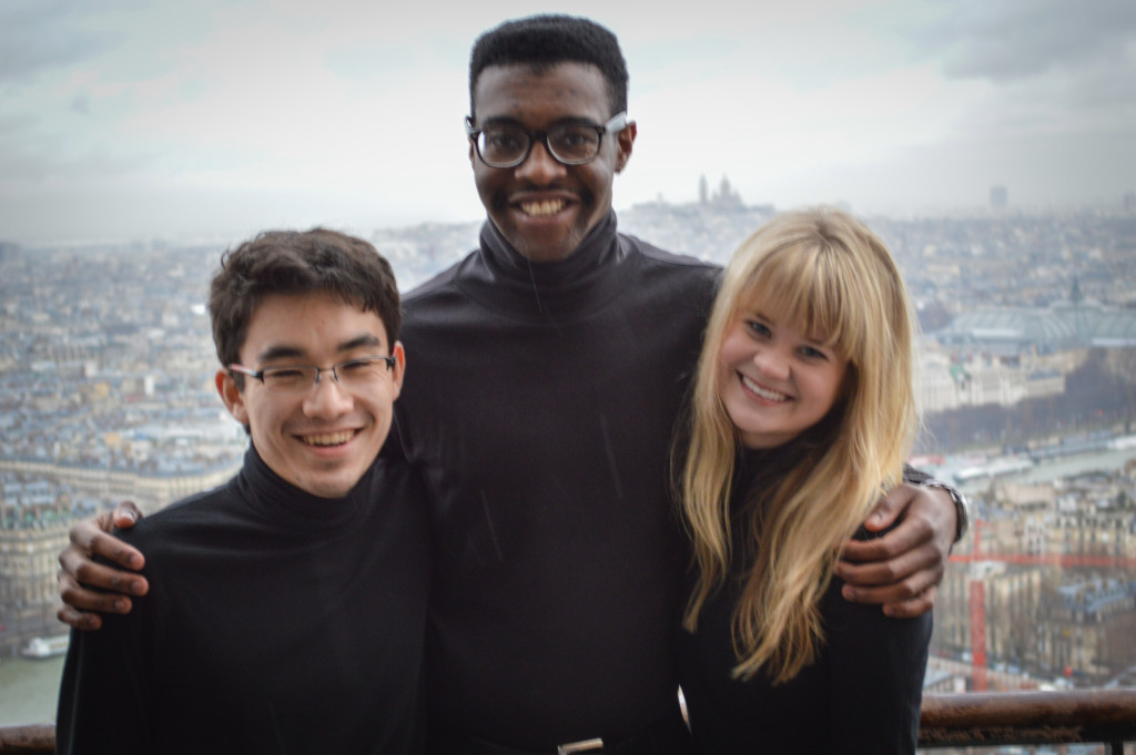 David Lim, Cameron Jarvis, and Allison Schmidt with Sacre Cœur visible in the background.